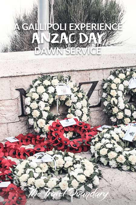 White floral wreaths and red poppy wreaths lay at the memorials to commemorate fallen soldiers at Gallipoli, Turkey