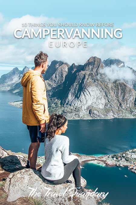 Bevan and Jasmine of The Travel Quandary look out over Reine from Reinebringen in the Lofoten Islands, Norway