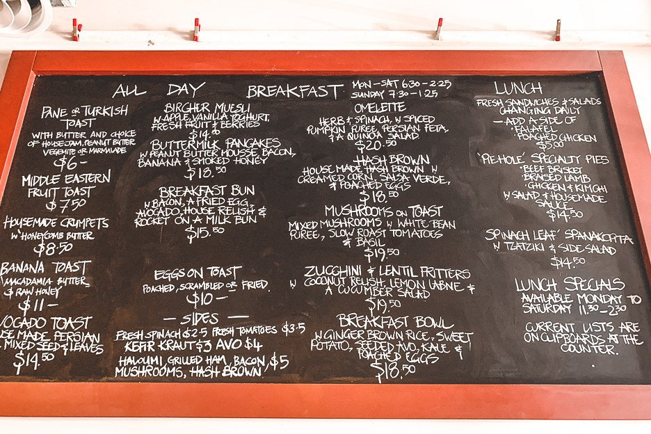All day breakfast menu on the chalkboard at Plenty Cafe in West End, popular breakfast cafe in Brisbane