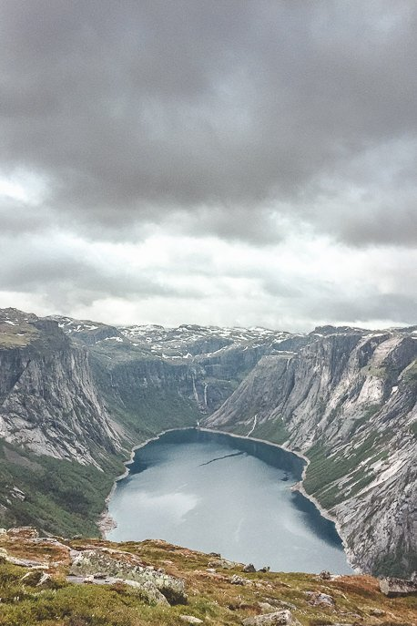 The view out over the fjord under misty skies - Trolltunga, Norway
