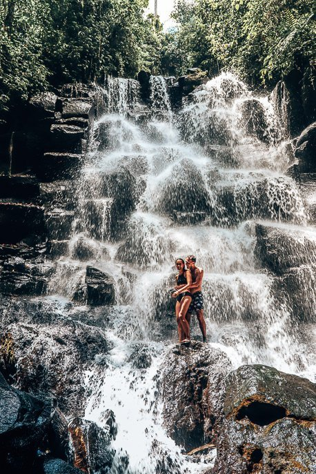 Jasmine and Bevan standing under Kanto Lampo waterfall, Bali Gallery