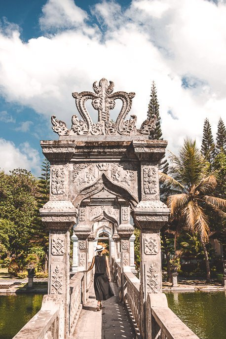 Jasmine walks under the arches of a walkway at Ujung Water Palace, Bali Gallery