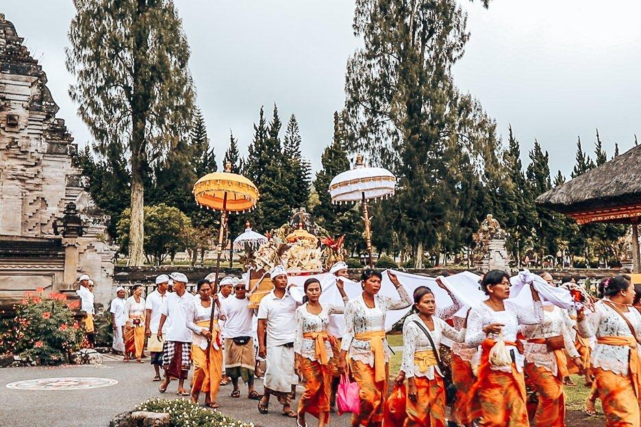Locals walk into Danu Beratan Temple to pray, Bali Gallery