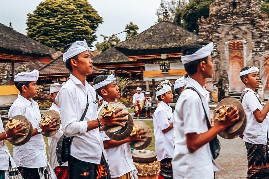 Young boys play music coming into Danu Beratan Temple, Bali Gallery