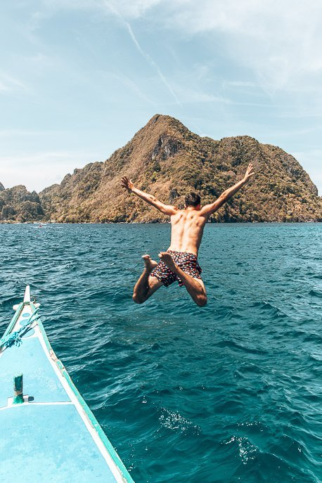 Bevan jumps off the tour boat whilst on Tour D in El Nido
