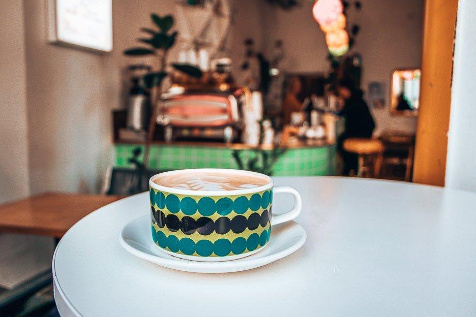 Hot latte on counter at Kohvik August, Tallinn
