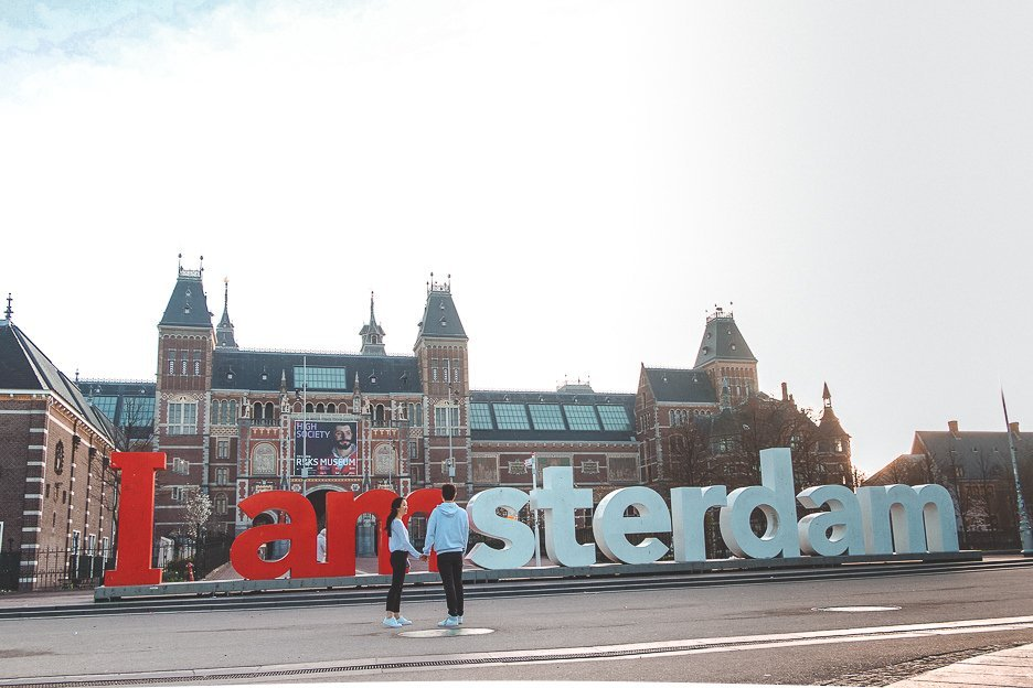Standing in front of the Iamsterdam sign at dawn, Amsterdam