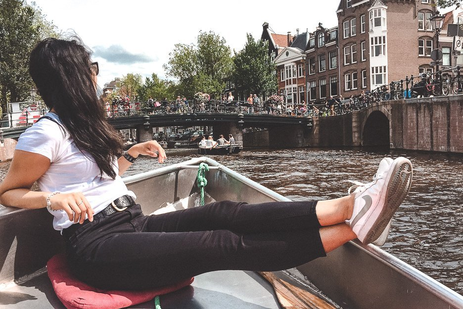 Chilling in a motor boat cruising down the canals in Amsterdam