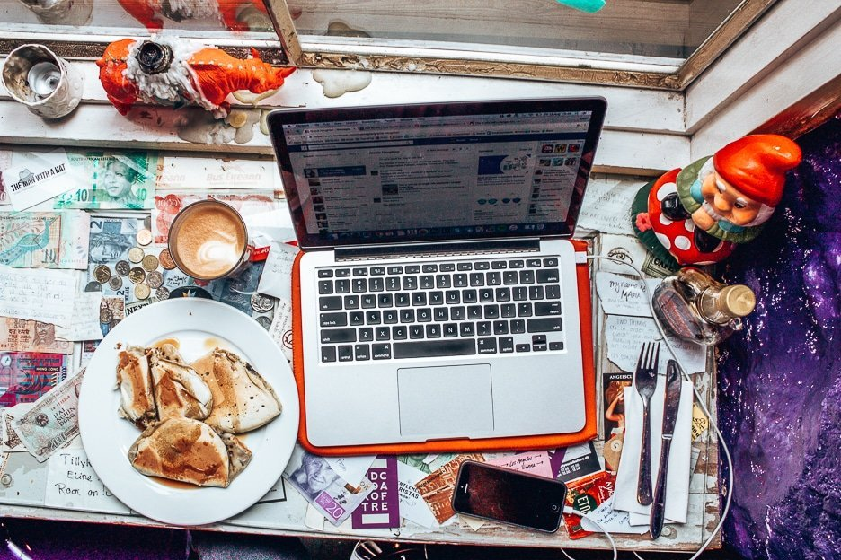 Working breakfast, laptop coffee and pastry in a Copenhagen cafe