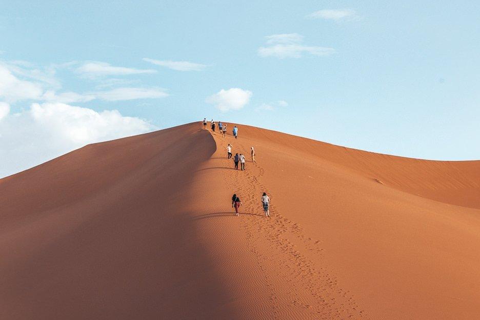 Climbing sand dunes in the Sahara Desert, Morocco