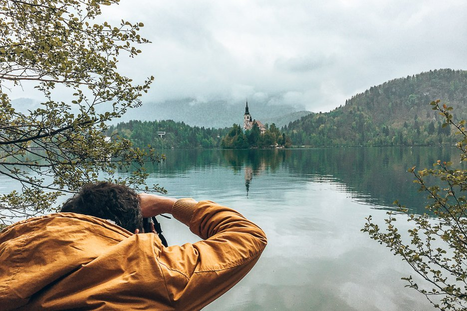 Bevan taking photos of Bled Island at Lake Bled, Slovenia