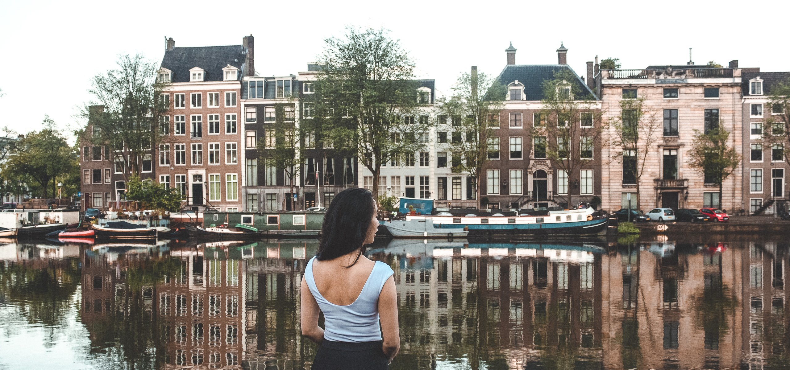 Jasmine standing by the canals in Amsterdam