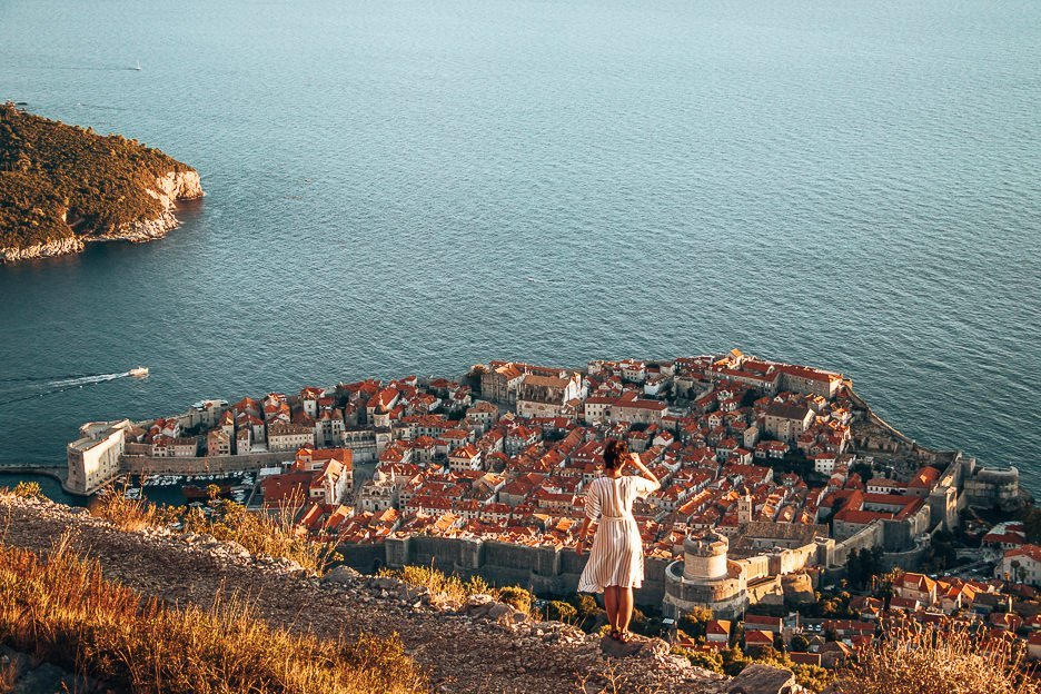 Jasmine looks out over Dubrovnik Old Town at sunset, Croatia