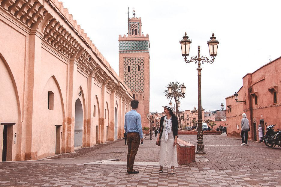 Jasmine and Bevan of The Travel Quandary stand outside Katoubia Mosque, Marrakech Morocco