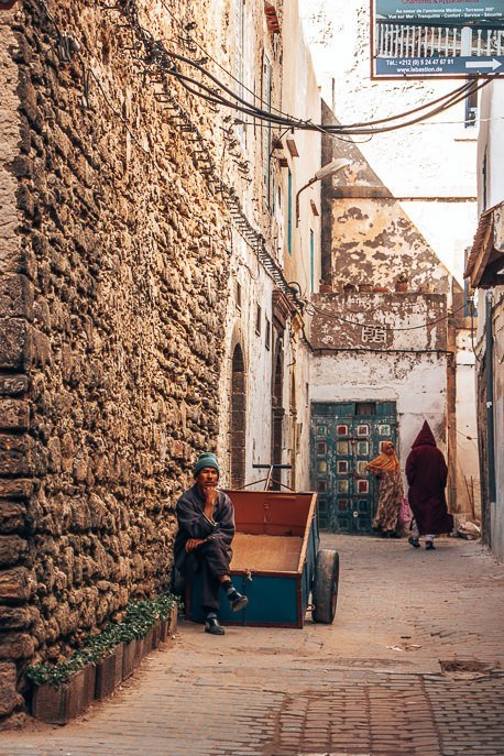 A man sits on his cart waiting for business in the streets of Essaouira, Morocco
