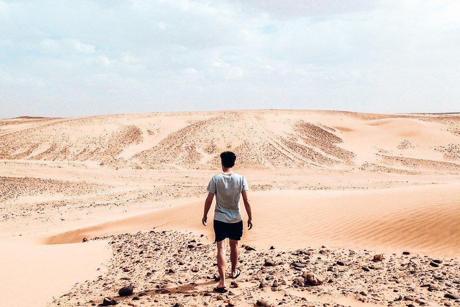 Bevan of the Travel Quandary walking in the Sahara Desert Morocco