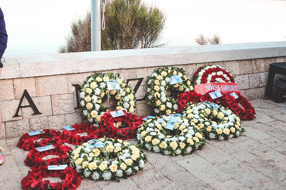 White and red floral wreaths are laid at the ANZAC memorial in Gallipoli, Turkey