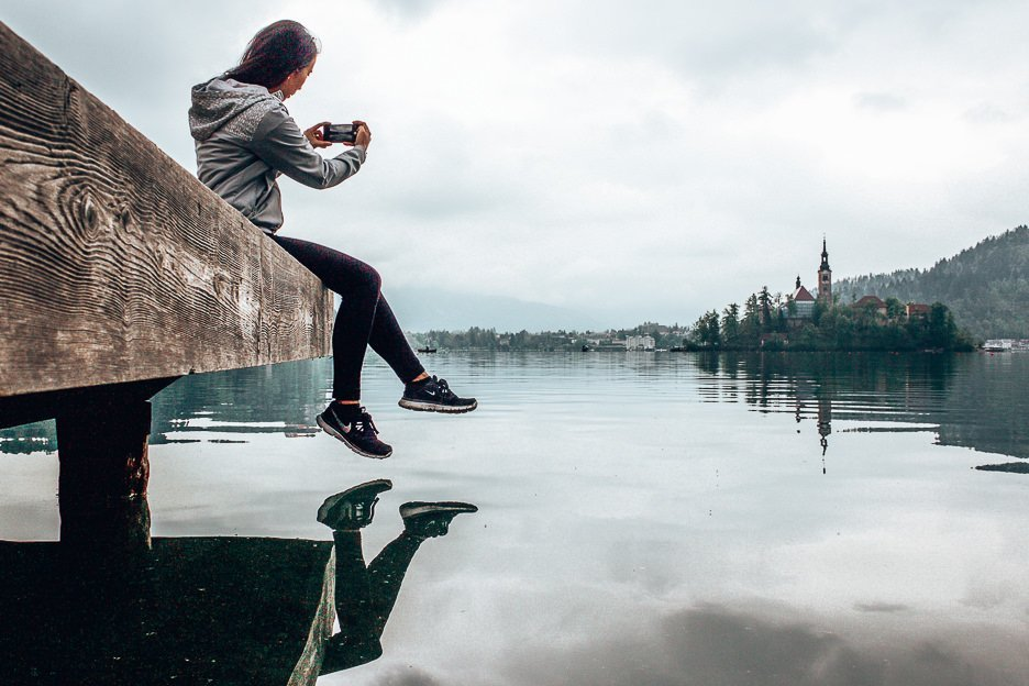 Taking an iPhone photo of Bled Island, Bled Lake, Slovenia