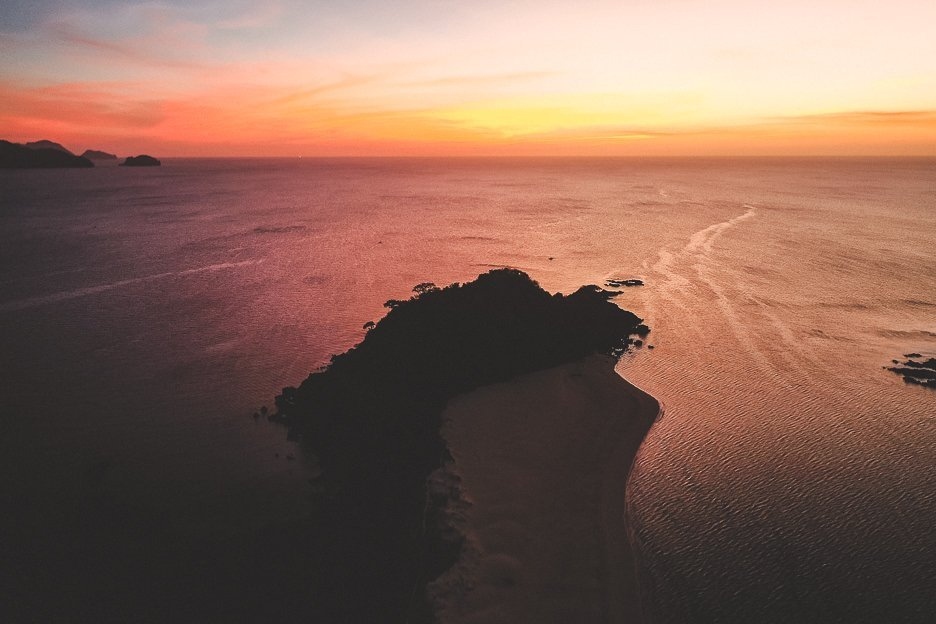 Drone capturing a glorious sunset over Nacpan Beach, El Nido