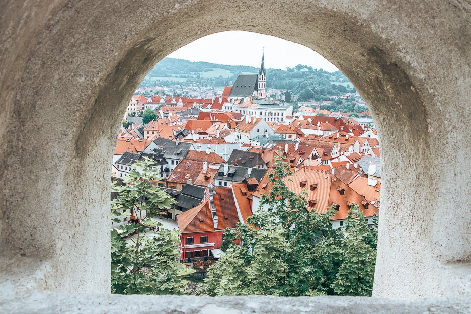 Through an arched window. Looking out over the town of Cesky Krumlov, Czech Krumlov
