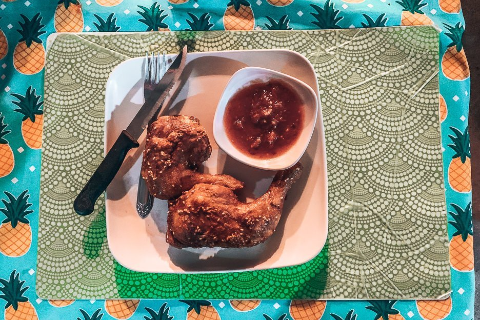 Two pieces of crispy friend chicken with chilli sauce at CFC, Siargao