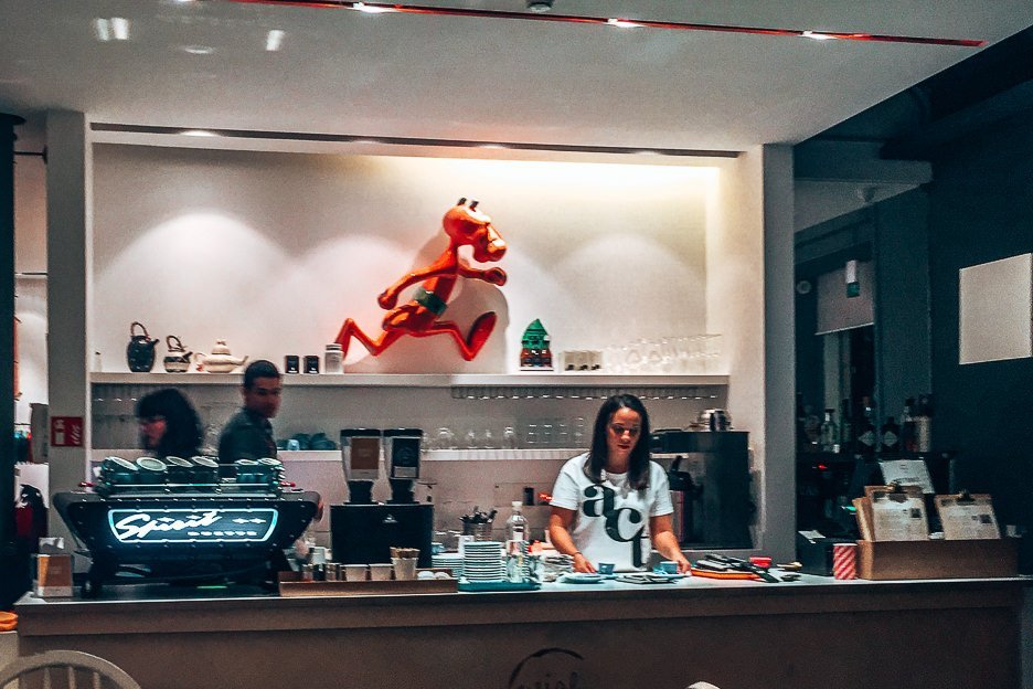 Baristas behind the counter at Wish Coffee, Lisbon Portugal