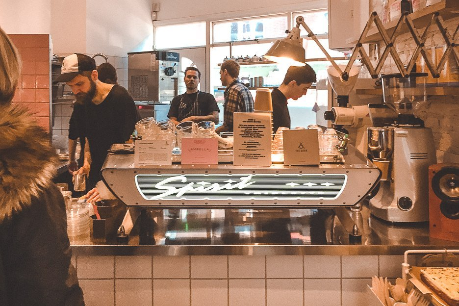 Baristas behind the counter at Milk, Balham