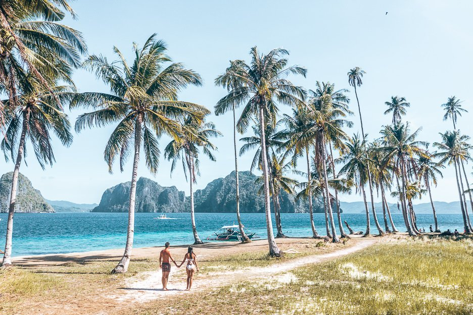 A couple walking on Pinagbuyatan Island, El Nido, The Philippines