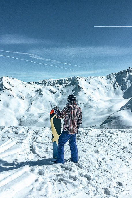 Bevan taking in the views with his snowboard at Val Thorens, France