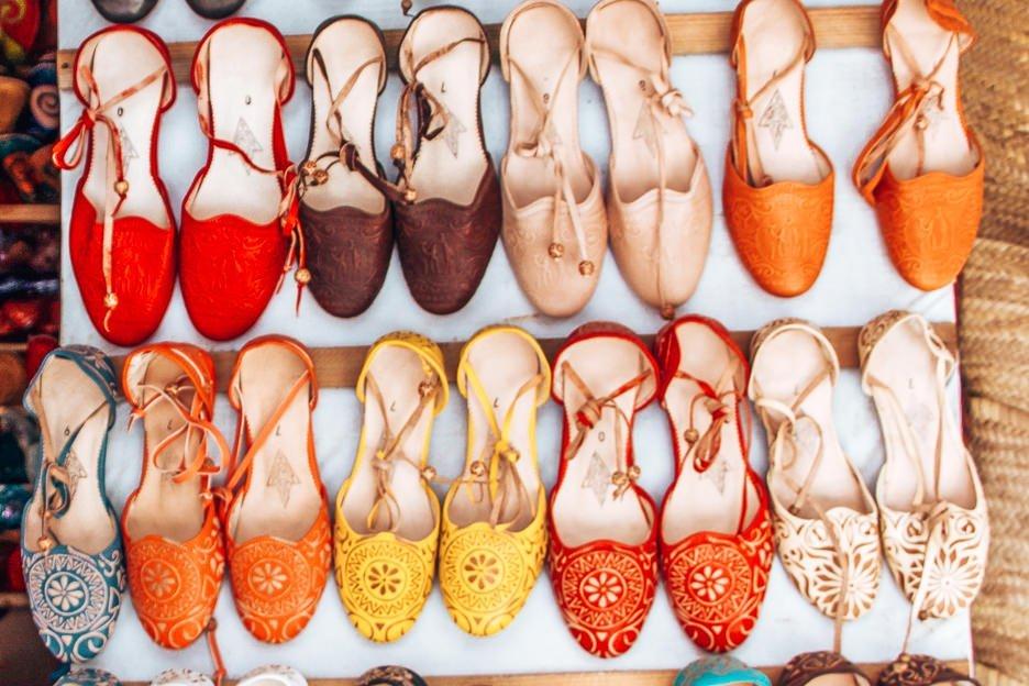 Shoe shopping in Essaouira's souks, Morocco
