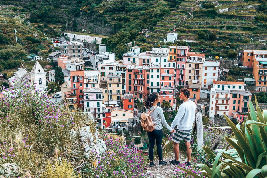 Holding hands and admiring the view of Manarola, Cinque Terre