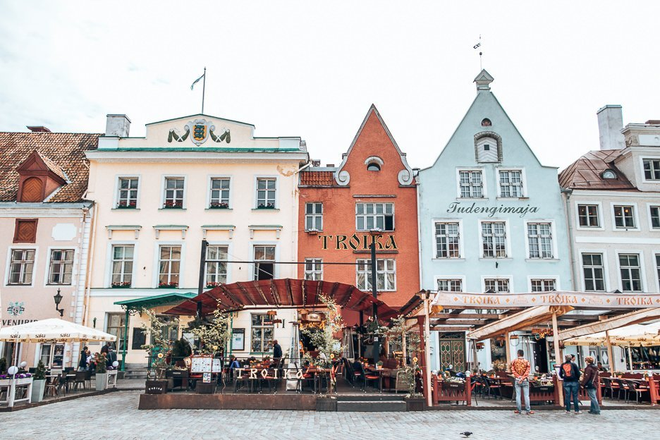 Restaurants in front of colourful facades in the Old Square, Tallinn