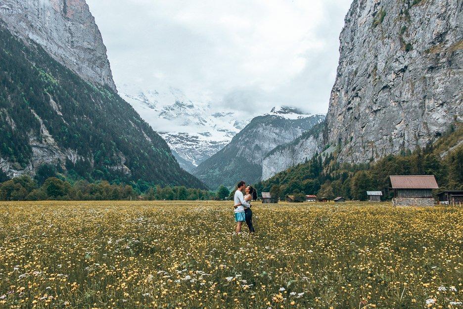 Sharing a kiss in a field of wildflowers, Interlarken Switzerland