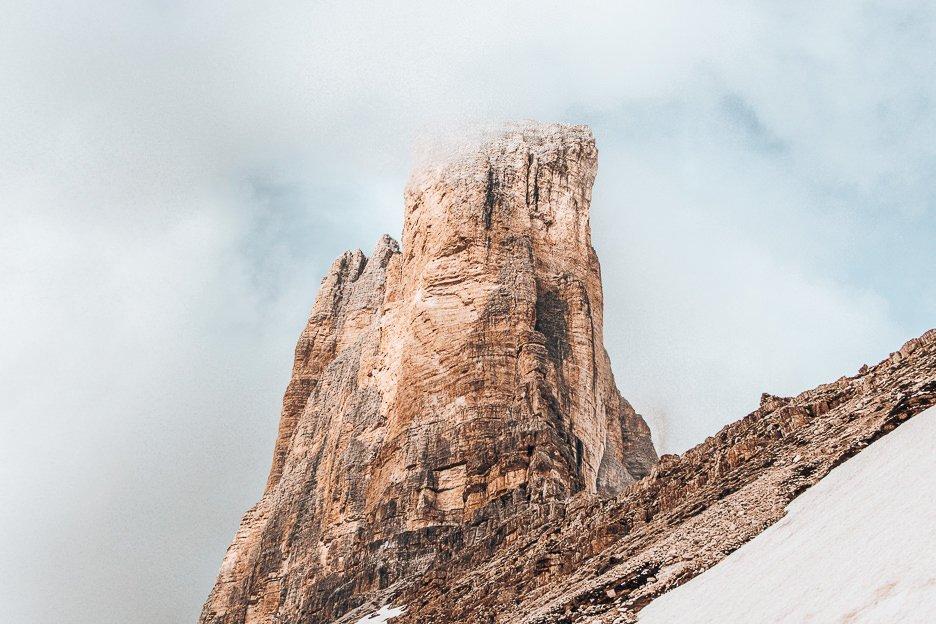Fog clouding over the peaks of Tre Cime di Lavaredo, The Dolomites, Italy