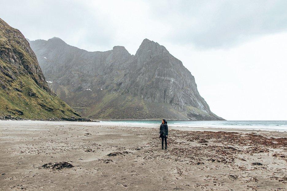 Jasmine standing on Khalika Beach - Lofoten Islands, Norway