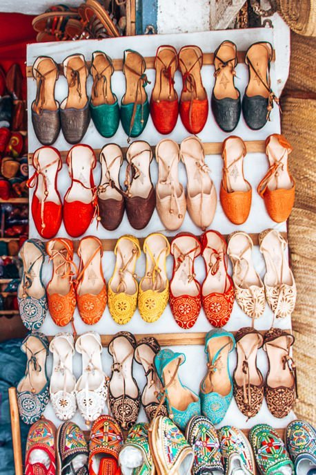 Shoe shopping in the souks of Essaouira, Morocco
