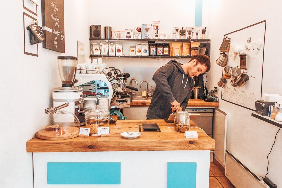 Barista making coffee at Kaffeemodul, Vienna
