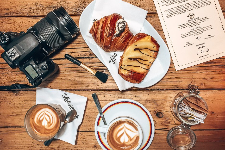 A flatlay of two flat whites and sweet pastries at Ditta Artigianale in Florence, Italy - a cafe for the best coffee in Europe