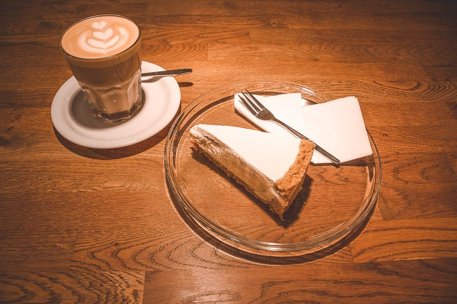 A latte and slice of cheesecake at Five Elephant, Berlin Germany - best coffee in Europe