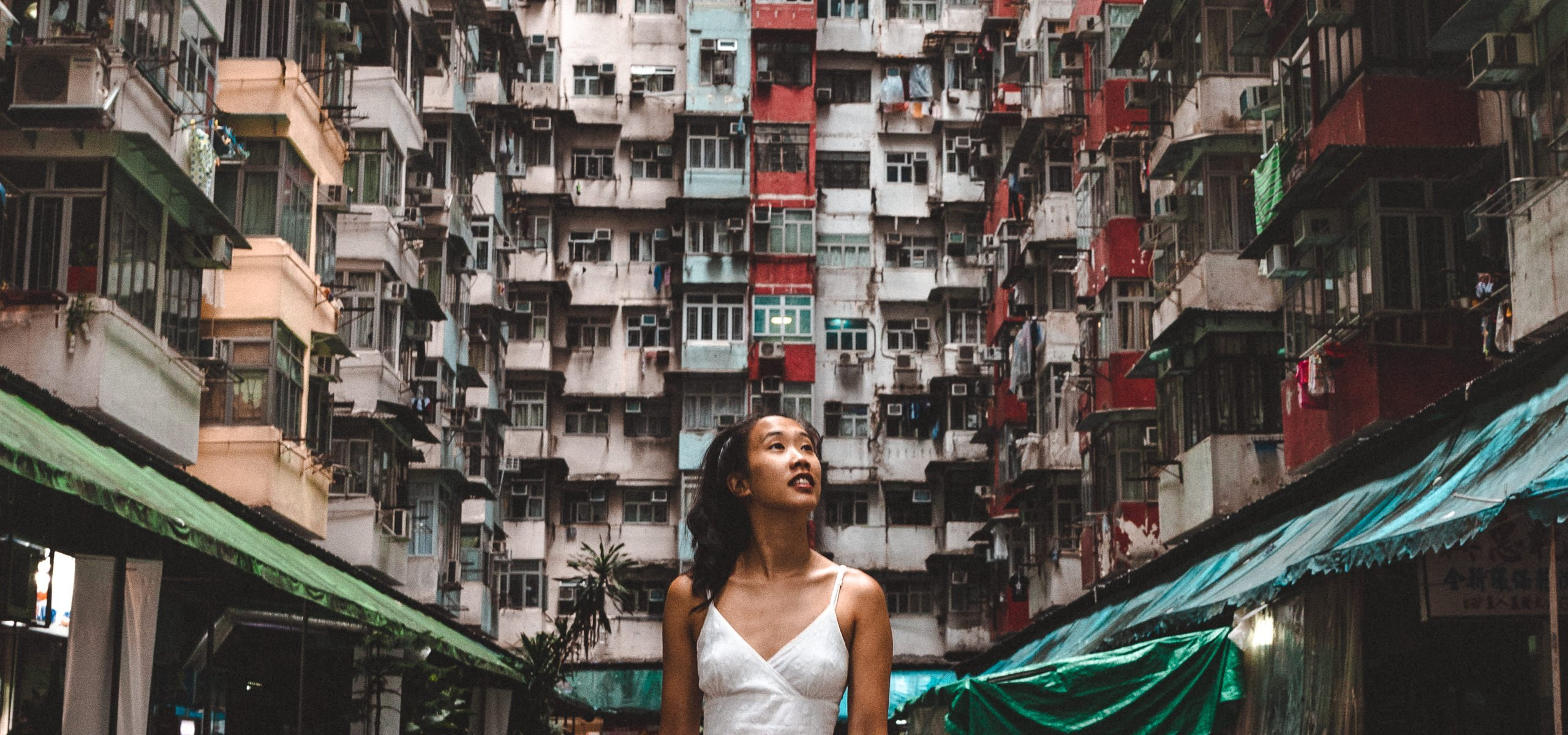 A girl poses in front of Montane Mansion, Hong Kong