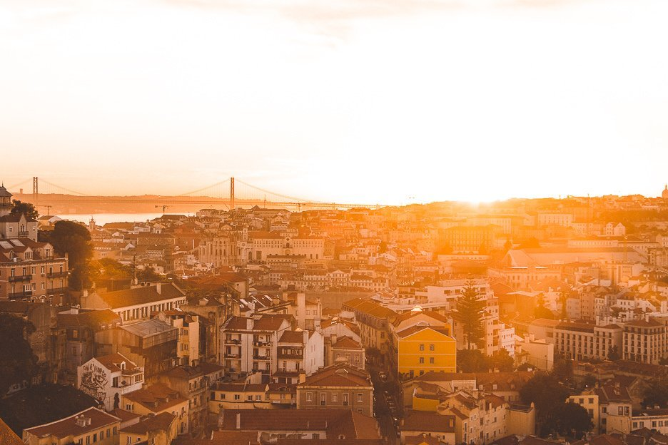 A golden sunset over the city of Lisbon, Portugal