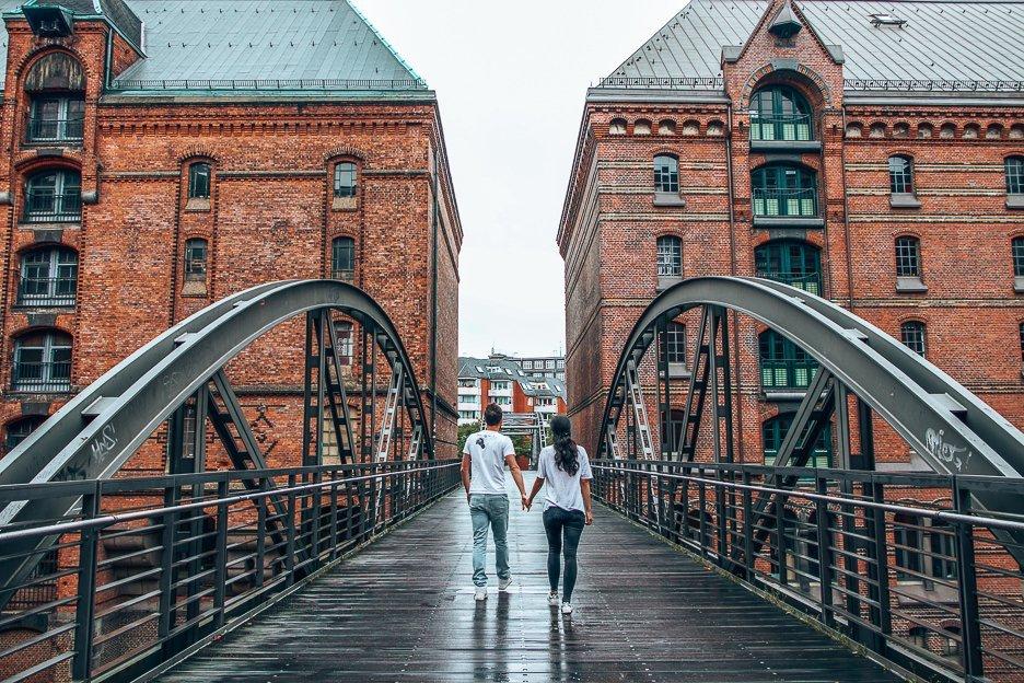 A couple walk over one of the bridges inSpeicherstadt, Hamburg, Germany