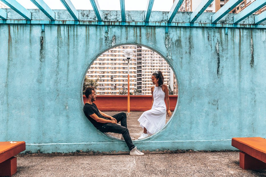 A couple pose in one of the circles of Lok Wah South Estate Car Park, Hong Kong