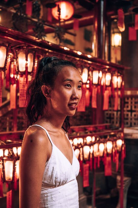 Jasmine poses inside Man Mo Temple, Hong Kong