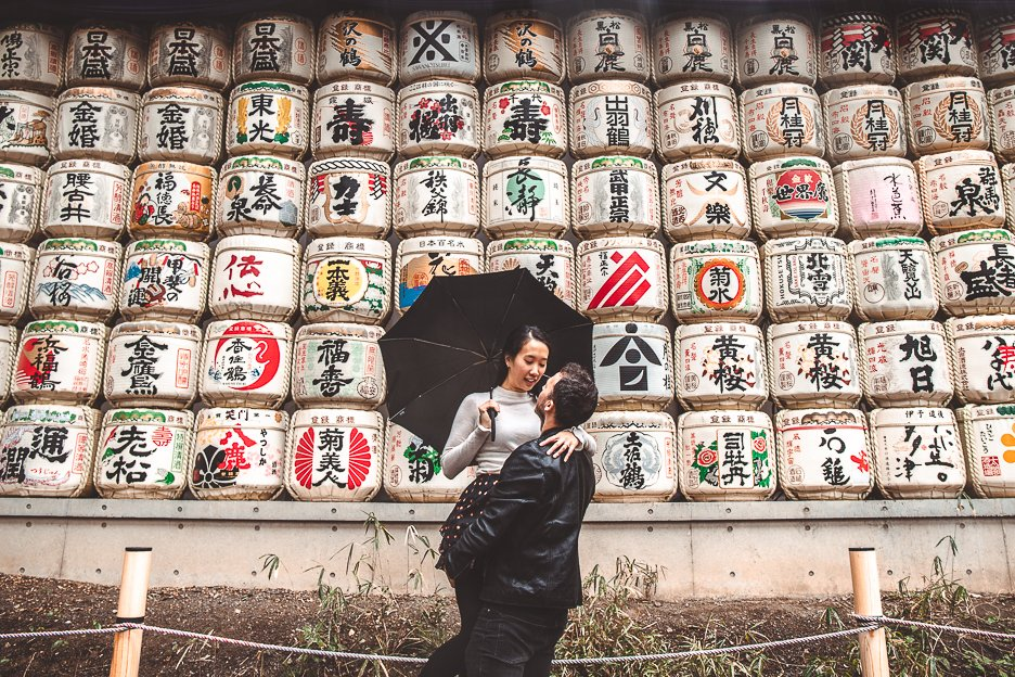 A couple pose in front of the sake barrels at Meiji Jinku, next to Yoyogi Park | Shibuya what to see
