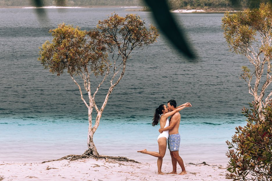 Sharing a kiss on the sand at Lake McKenzie, Fraser Island