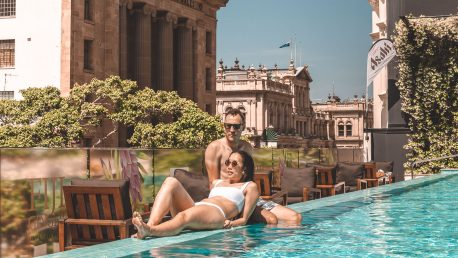 Next Hotel Brisbane Review | lounging on the edge of the infinity pool