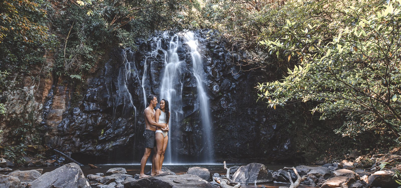 A couple pose for a photo at Ellinjaa Falls