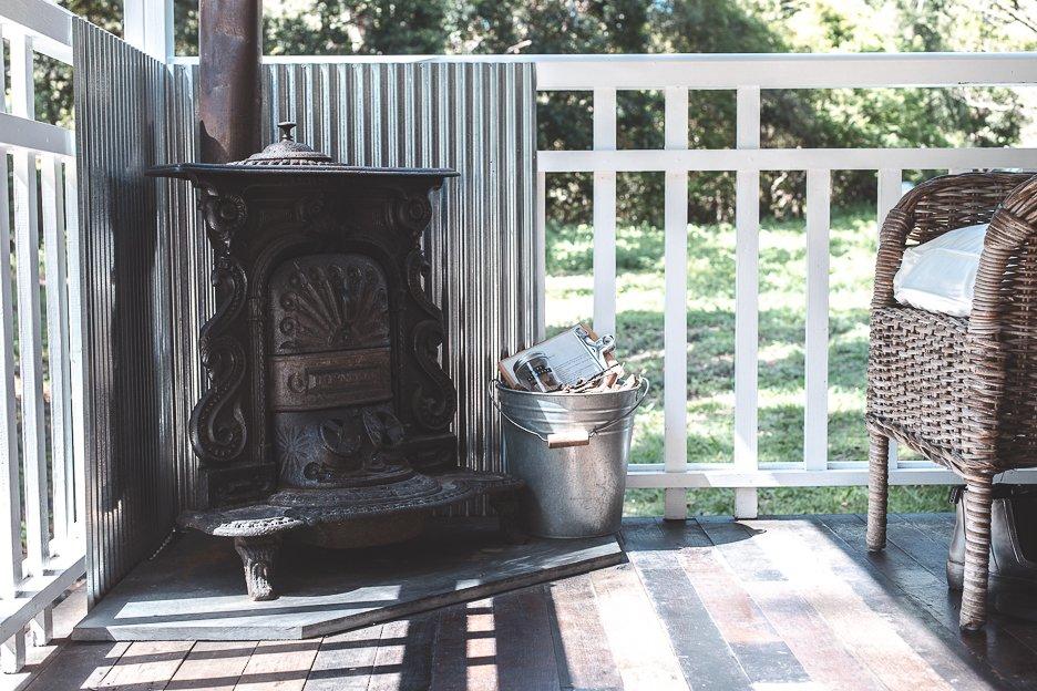 Cast iron fireplace on the porch - Palmer & Gunn